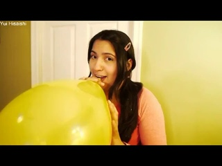 CHICK BLOWS A YELLOW BALLOON TO POP