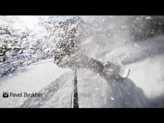Powder turn in slow motion, snowboarder man and girl riding