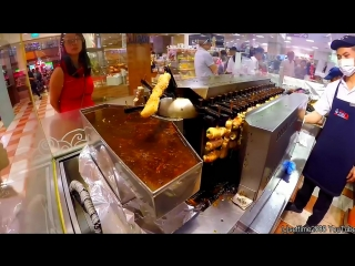 Amazing automatic machine to cook japanese yakitori skewers. singapore street fo
